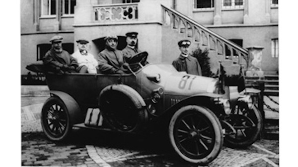 Black and white photo of the Miele convertible with four men in it.